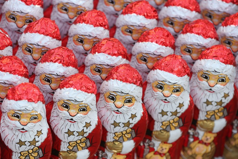 Chocolate figurines in the form of St. Nicholas, or Santa Claus, stand in rows before they were given to participants in the 7th annual Michendorf Santa Run on December 6, 2015 in Michendorf, Germany. A record 900 runners took part in this year's event, which included 2,5km, 5km and 10km races. (Photo by Sean Gallup/Getty Images)