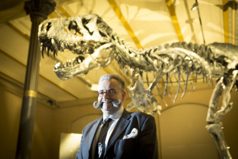 Johannes Vogel, director of the Berlin Natural History Museum stands next to the skeleton of Tristan the Tyrannosaurus Rex during a media preview at the Museum fuer Naturkunde (Natural History Museum) on December 16, 2015 in Berlin, Germany. The skeleton, unearthed in the U.S. state of Montana in 2012, is among the best-preserved large dinosaur skeletons ever found. Tristan is approximately 66 million years old, is 12 meters long and is the first complete Tyrannosaurus Rex to ever be displayed in Europe. Tristan will be on exhibition at the Berlin natural history museum for the next three years. (Photo by Axel Schmidt/Getty Images)