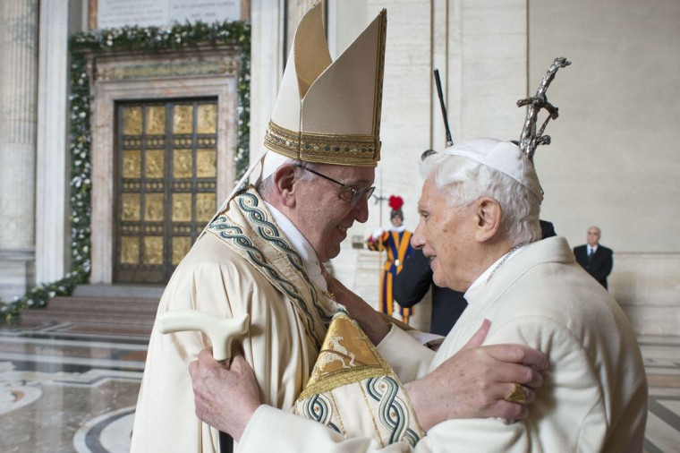 "This handout picture released by the Vatican press office shows Pope Francis (L) welcoming Pope emeritus Benedict XVI before the opening of the ""Holy Door"" to mark the start of the Jubilee Year of Mercy, on December 8, 2015 in Vatican. Pope Francis marks the start of an extraordinary Jubilee year for the world's 1.2 billion Catholics by opening a ""Holy Door"" in the walls of St Peter's basilica. At 9.30 am (0830 GMT), the Argentinian pontiff will pronounce the words ""Aperite mihi Porta Iustitiae"" -- Latin for ""open to me the gates of justice"" -- and the door, which is normally bricked up, will be opened. (AFP Photo/Osservatore Romano)"