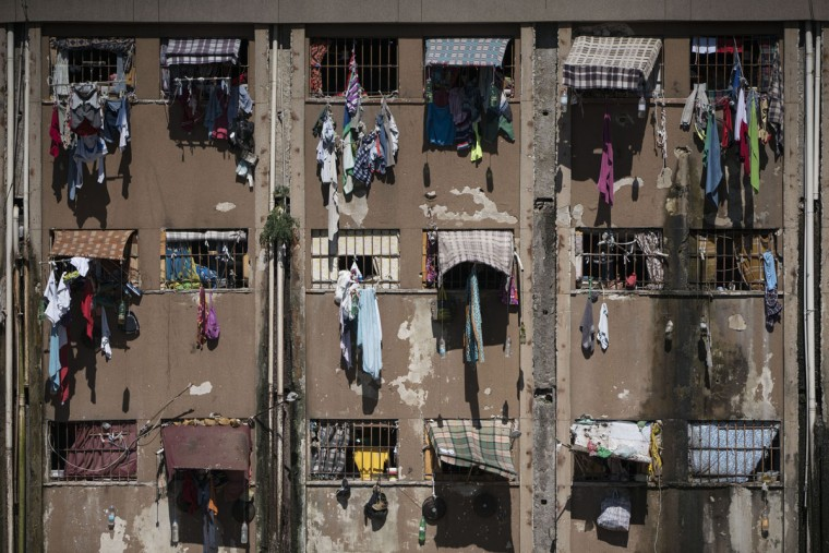 In this Nov. 30, 2015 photo, clothing hangs from the overcrowded cells at the Central Prison in Porto Alegre, Brazil. With more than 600,000 inmates behind bars, Brazil has the fourth-largest prison population in the world after the United States, China and Russia, according to Brazil's Justice Ministry. (AP Photo/Felipe Dana)