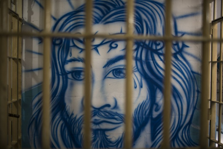 "In this Nov. 30, 2015 photo, a mural of Jesus decorates the wall of a cell used by prisoners who joined a work program at the Central Prison in Porto Alegre, Brazil. Eugenio Terra, president of the Porto Alegre Association of Judges, denounced the prison's conditions before the Human Rights Commission of the Organization of American States in 2013. ""We want incarceration to take place with dignity,"" he said, ""because the way it is done today favors the gangs and the power they hold at the prison."" (AP Photo/Felipe Dana)"