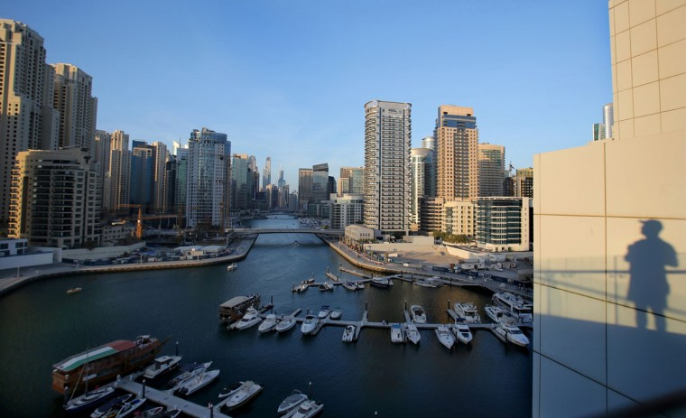 Yachts are moored at the southern end of the Marina waterfront in Dubai, United Arab Emirates. High-rise buildings, stacked row after row, make up this 50 million sq. foot (4.65 million sq .meter) waterfront neighborhood that is built around a man-made canal. Owning an apartment in one of these towers means access to skyline pools, concierge services and grand apartments that cater to the regionís royalty, as well as the worldís wealthiest businessmen and women. (AP Photo/Kamran Jebreili)