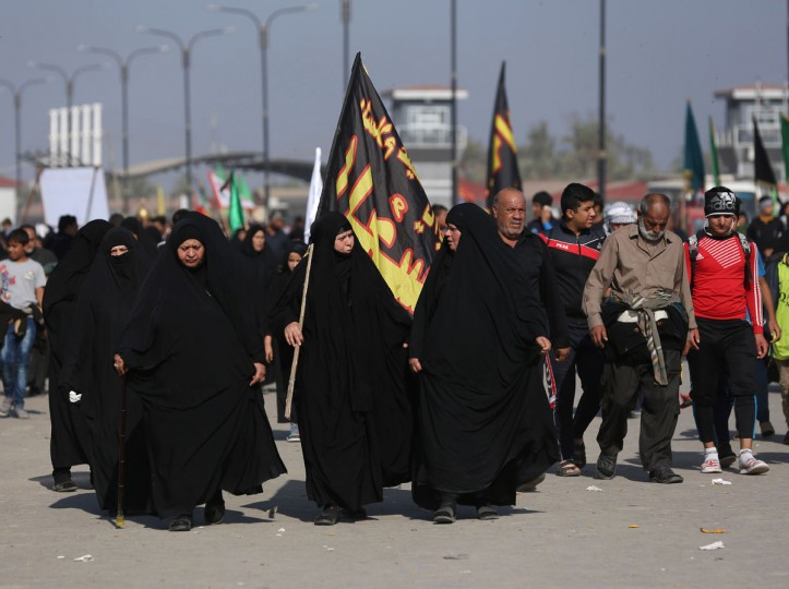 In this Sunday, Nov. 29, 2015, photo, Shiite pilgrims march to Karbala during the Arbaeen ritual in Baghdad, Iraq. Iraqi officials say security was stepped up this year for the millions of pilgrims who descended on the holy city of Karbala to mark the commemoration of Arbaeen Wednesday. (AP Photo/Hadi Mizban)