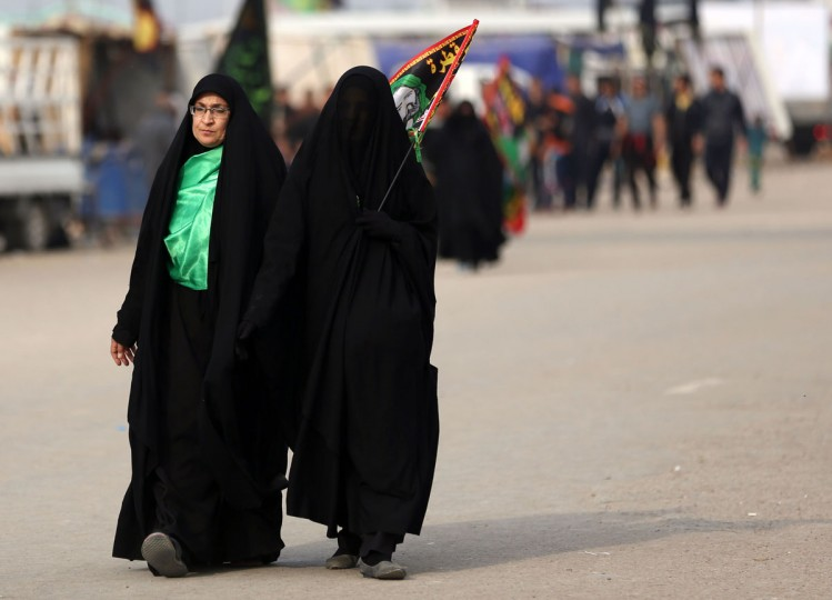 Shiite pilgrims march to Karbala for the Arbaeen ritual in Baghdad, Iraq, Tuesday, Dec. 1, 2015. (AP Photo/Hadi Mizban)