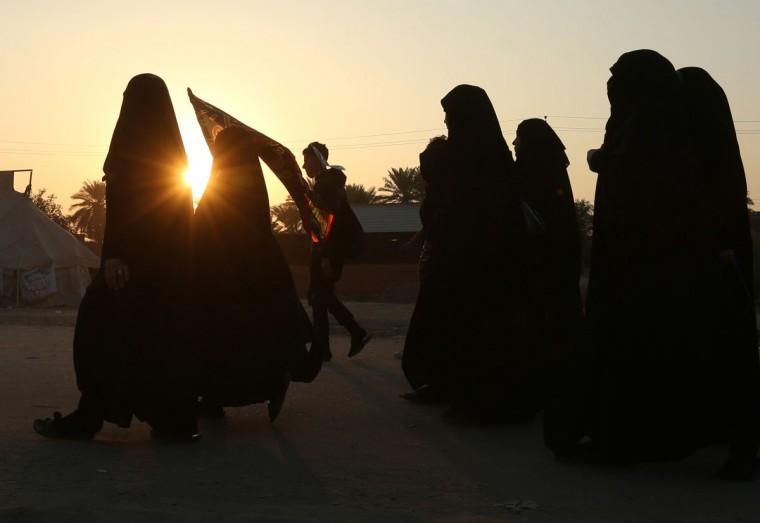 Shiite pilgrims march to Karbala during the Arbaeen ritual in Baghdad, Iraq, Sunday, Nov. 29, 2015. (AP Photo/Hadi Mizban)