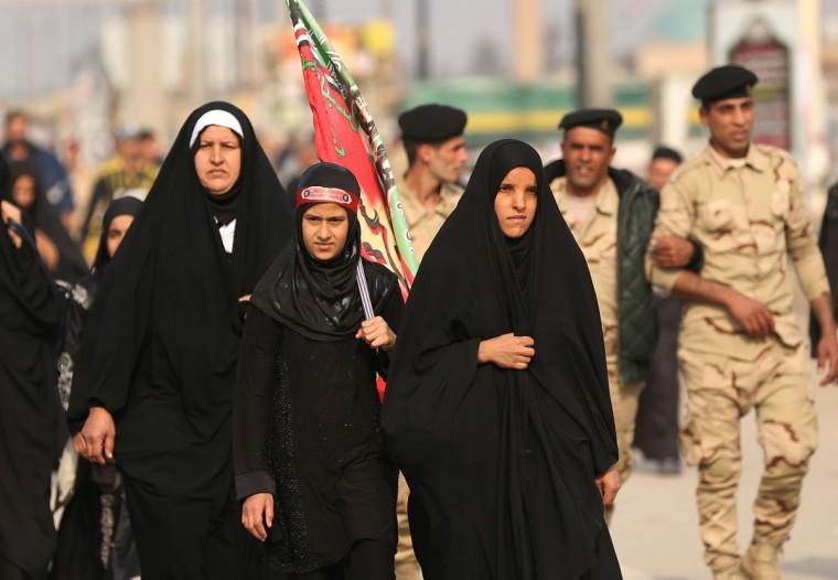 Shiite pilgrims march to Karbala for the Arbaeen ritual in Baghdad, Iraq, Tuesday, Dec.1, 2015. (AP Photo/Hadi Mizban)
