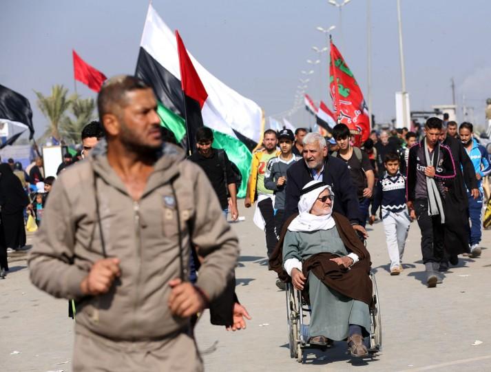 Shiite pilgrims march to Karbala for the Arbaeen ritual in Baghdad, Iraq, Sunday, Nov. 29, 2015. (AP Photo/Hadi Mizban)