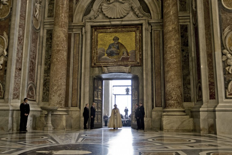 Pope Francis enters St. Peter's Basilica after opening the Holy Door, at the Vatican, Tuesday, Dec. 8, 2015. Pope Francis pushed open the great bronze doors of St. Peter's Basilica on Tuesday to launch his Holy Year of Mercy, declaring that mercy trumps moralizing in his Catholic Church. (AP Photo/Andrew Medichini)