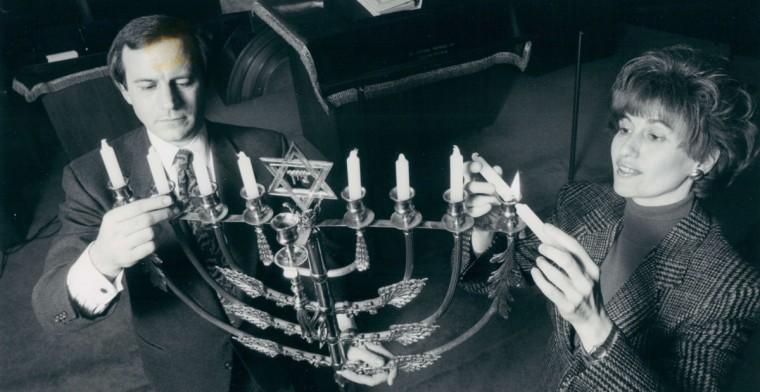 A Beth Tfiloh Congregation, Rabbi Mitchell Wohlberg and Zipora Schorr ready the menorah for the celebration of Hanukkah. (Jed Kirschbaum/Baltimore Sun, 1990)