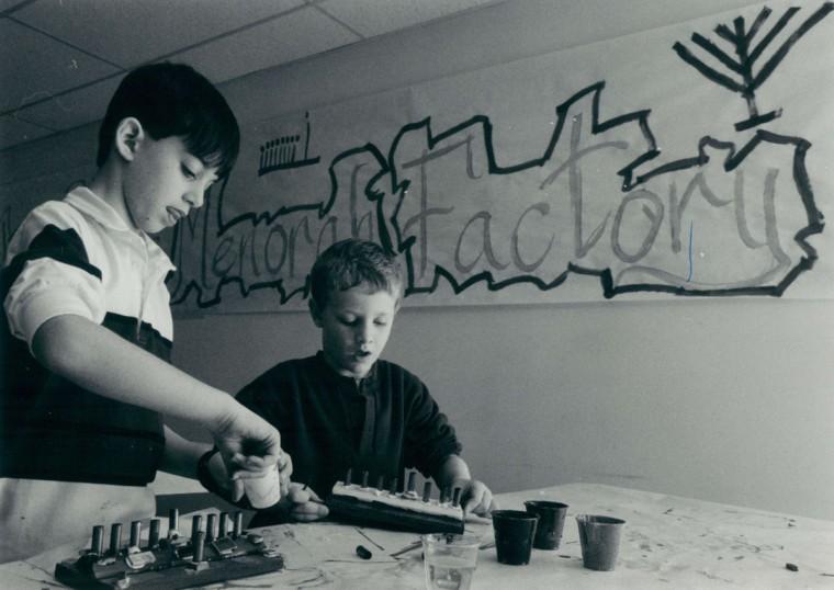 Kids make menorahs at The Lubavitch Center in Columbia, Md. Rabbi Hillel Baron called this the menorah factory. (Randall K. Wolf/Baltimore Sun, 1987)