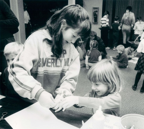 Oakland Mills Hanukkah party - Wendy Brodsky, 10, and Jackie Taubman, 4, make greeting cards. (Baltimore Sun, 1987)