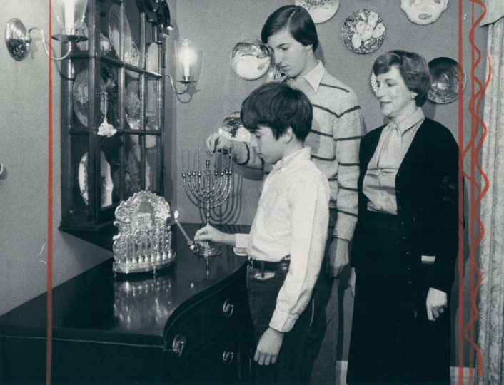 Fredrica Saxon watches as her sons Jack, 12, and Ken 16, light their menorahs. (Richard Childress/Baltimore Sun, 1978)