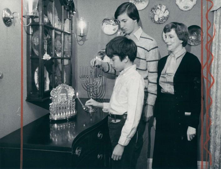 Fredrica Saxon watches as her sons Jack, 12, and Ken 16, light their menorahs. (Richard Childress/Baltimore Sun, 1978)