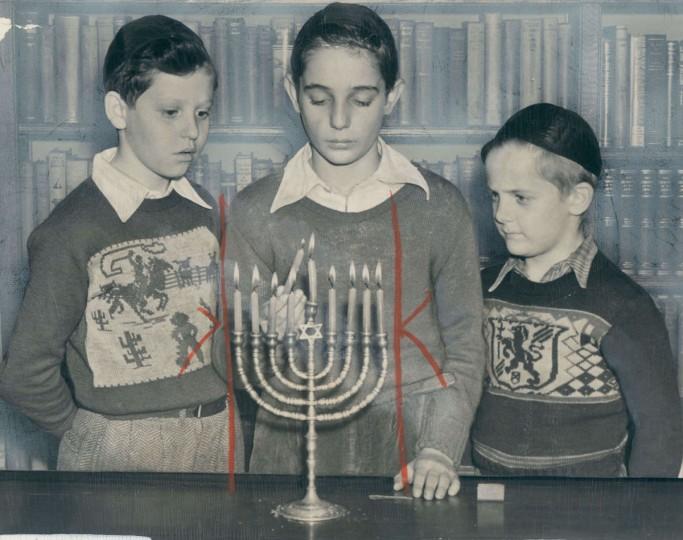 Allen Snyder, Stanley Oppenheim and Elliott Oppenheim light Hanukkah candels to celebrate the Feast of Lights. (Joshua Cosden/Baltimore Sun)