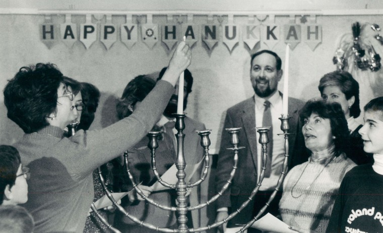 Peggy Wolf, president of the Jewish Community Center, prepares to light the first candle, representing the first night of Hanukkah. (Amy Davis/Baltimore Sun, 1987)