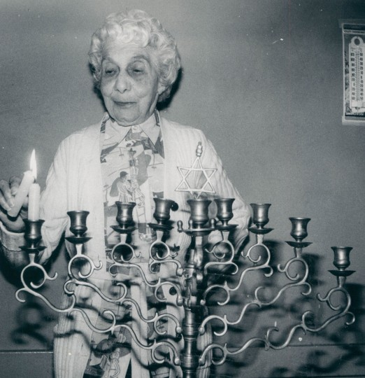 Etta Marovitz lights first of eight menorah candles during a pre-Hanukkah party at Levindale. (Joseph A. DiPaola/Baltimore Sun, 1979)