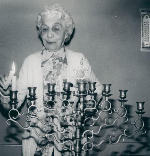 Etta Marovitz lights first of eight menorah candles during a pre-Hanukkah party at Levindale. (Joseph A. DiPaola/Baltimore Sun, 1979)