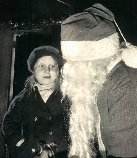 "Tracy Knight, 7: ""No, he's not Santa, really. He's a boy dressed like Santa. I still like to him him though."" (Irving Phillips/Baltimore Sun, 1972)"