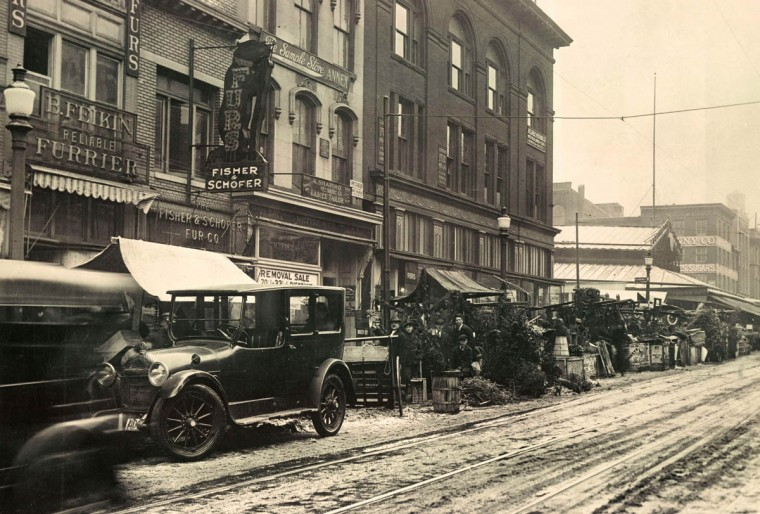 Christmas greenery was sold from makeshift stalls downtown in the early 1900's. The scene is the west side of Eutaw street , just south of Lexington street. (Baltimore Sun)
