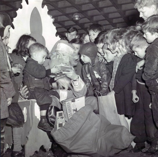 Santa hands out gifts at the Evening Sun Christmas party in 1940. (Baltimore Sun)
