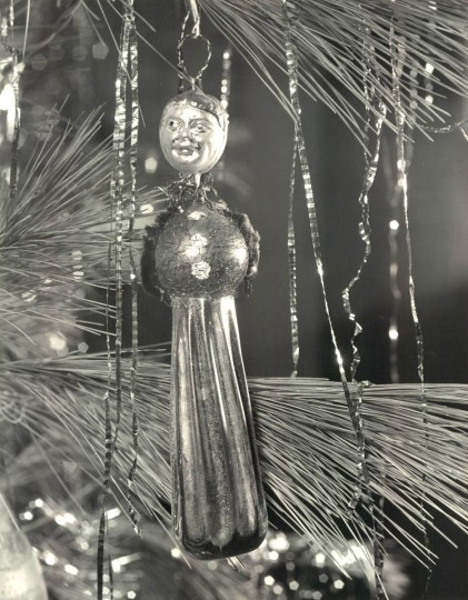 An unusual hand blown figure with a face, front, and back is seen on the Bodine Christmas tree in 1963. (A Aubrey Bodine/Baltimore Sun)