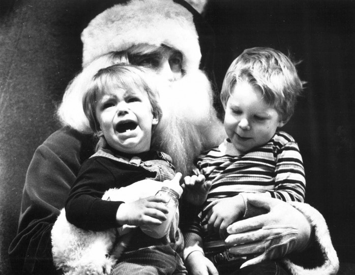 Meeting Santa didn't exactly make one-year-old Bobby Blair's day in December 1980. Although, the loud one's brother, Jerry Blair, 3, was amused. (Jed Kirschbaum/Baltimore Sun)