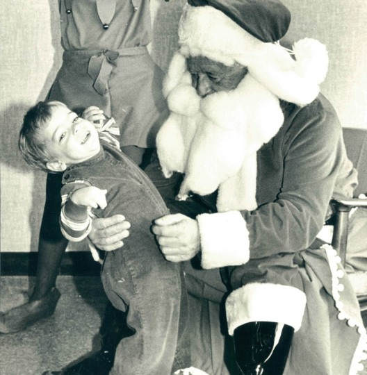 "Christopher Davis, 2-1/2, of Baltimore was reluctant to tell Santa Claus his ""wants"" for Christmas at Villa Julie Christmas party in 1983. (Lloyd Pearson/Baltimore Sun)"