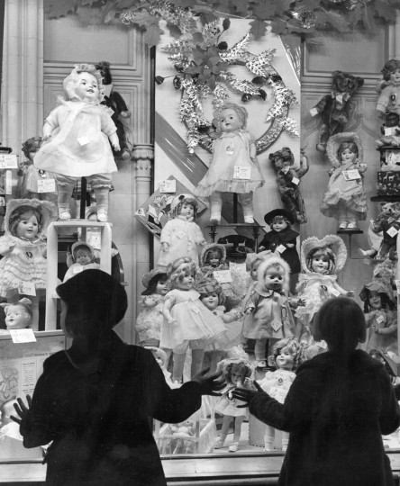 Two young girls, take in a display of dolls in a downtown department store in 1938. (A Aubrey Bodine/Baltimore Sun)