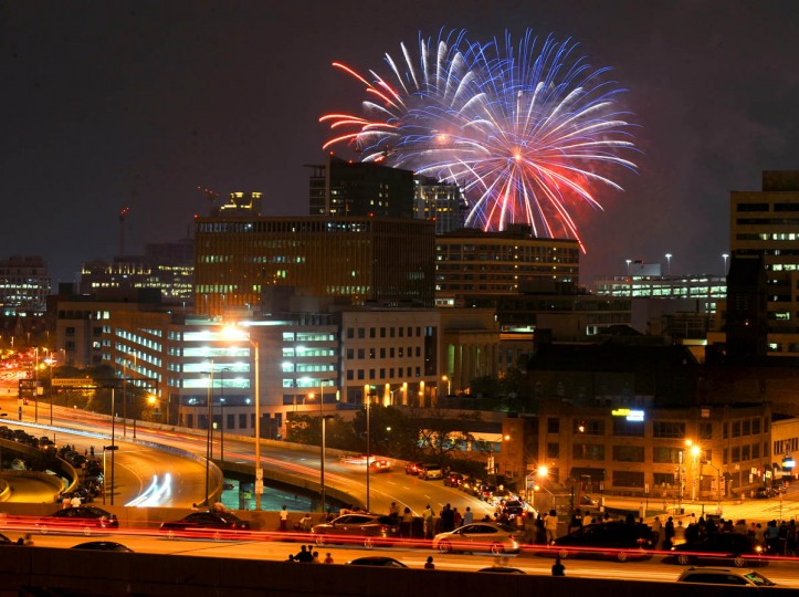 Spectators watch the 4th of July fireworks from the Orleans Street bridge. (Jerry Jackson/Baltimore Sun)