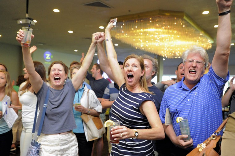 From left, Carol Frigo, Maria Wetherington, Jon Morgan (behind Maria) and Chuck Wetherington, all of Baltimore react as fans watch American Pharoah capture the Belmont Stakes, capturing the Triple Crown for the first time since Affirmed won in 1978. (Karl Merton Ferron/Baltimore Sun)
