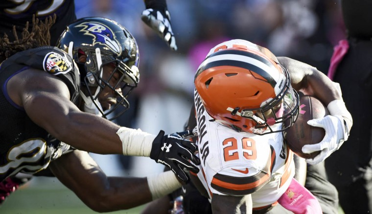 Ravens linebacker Za'Darius Smith (90) works to stop Browns running back Duke Johnson Jr. for no gain in overtime on 1st and 10 at the Baltimore 15. The Baltimore Ravens lose 33-30 in overtime to the Cleveland Browns at M&T Bank Stadium. (Christopher T. Assaf, Baltimore Sun)