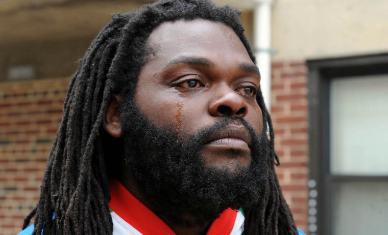 Kevin Moore is overwhelmed with joy on the news of charges filed against six Baltimore police officers in the death of Freddie Gray on May 1, 2015 in Baltimore, Md. Moore's video of Gray's arrest at Gilmor Homes has been seen around the world. (Jerry Jackson/Baltimore Sun)
