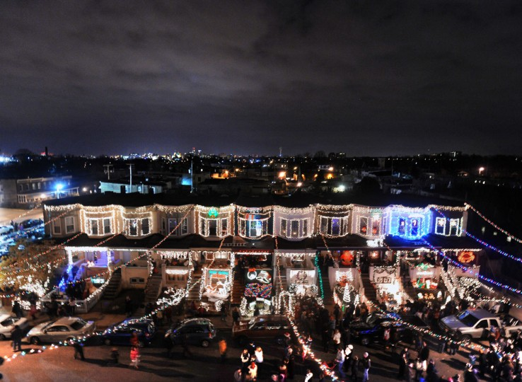 """The annual lighting of the """"Miracle on 34th Street"""" Christmas lights in Hampden showing the row houses on the south side of the street. (Kenneth K. Lam/Baltimore Sun)"""