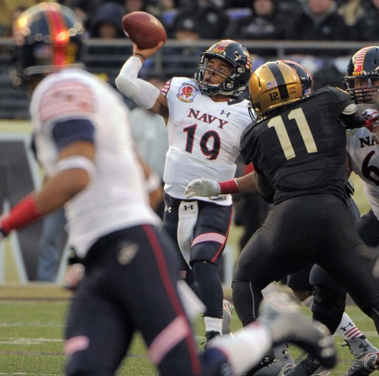 Navy Midshipmen quarterback Keenan Reynolds (19) makes a complete pass against the Army Black Knights during the second quarter of the 115th Annual Army Navy game Saturday, Dec 13, 2014. (Karl Merton Ferron / Baltimore Sun)