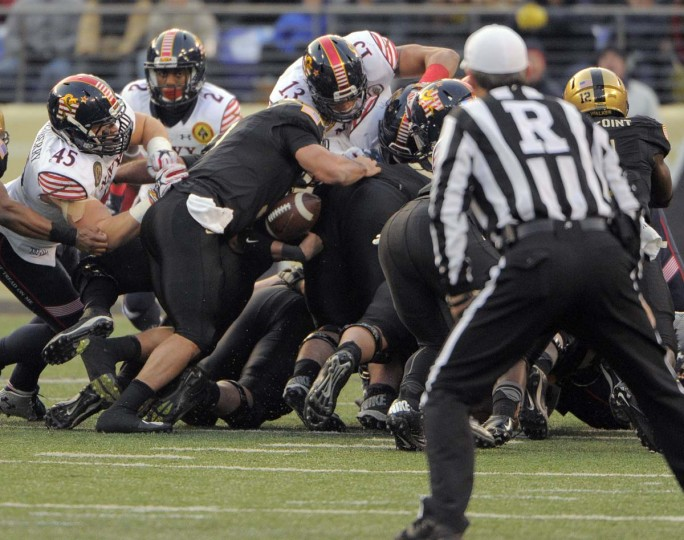 The football pops out on an Army Knights carry that was ruled dead with no call for a fumble during the second quarter of the 115th Annual Army Navy game Saturday, Dec 13, 2014. (Karl Merton Ferron / Baltimore Sun)