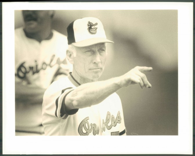 Cal Ripken Sr. points to an Oriole. (Baltimore Sun photo by Gene Sweeney Jr.)