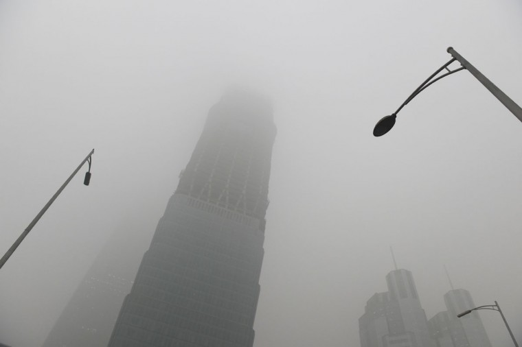 A skyscraper is shrouded in smog on a heavily polluted day in Beijing on December 1, 2015. (GREG BAKER/AFP/Getty Images)
