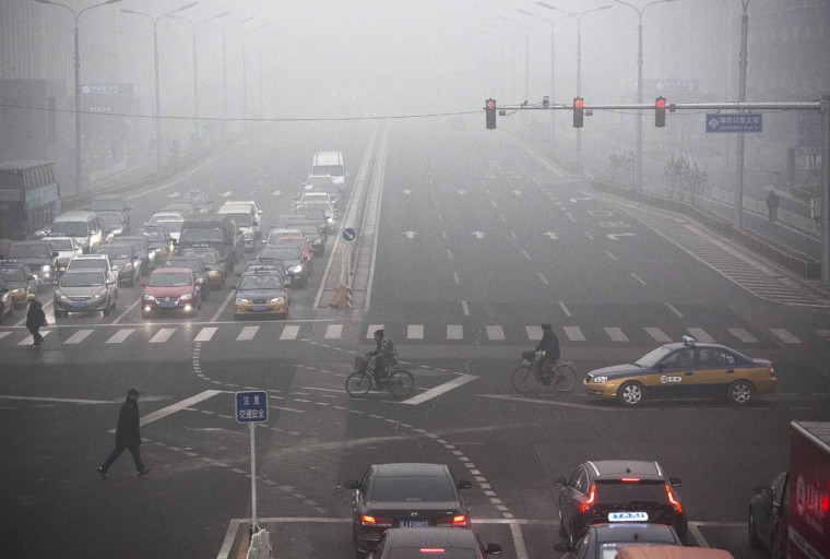 Traffic is seen on a day of high pollution on December 1, 2015 in Beijing, China. (Photo by Kevin Frayer/Getty Images)