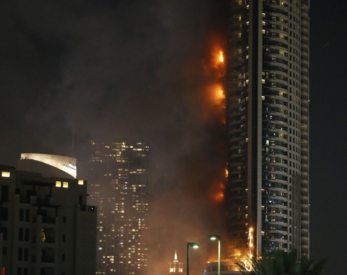 A picture taken on December 31, 2015 shows the Address Downtown hotel burning after huge fire ripped through the luxury hotel near the world's tallest tower, in Dubai. People were gathering to watch New Year's Eve celebrations when the hotel caught on fire without causing casualties, according to authorities. (KARIM SAHIB/AFP/Getty Images)