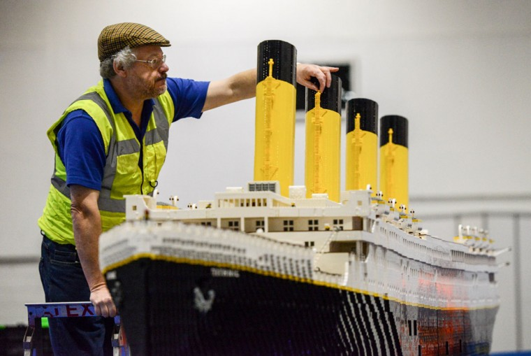 Lego builder Phil Traviss puts the finishing touches to his Titanic made out of 120,000 bricks over 3 months at ExCel on December 10, 2015 in London, England. (Photo by Chris Ratcliffe/Getty Images)