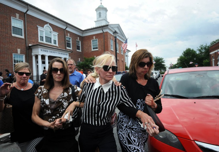 In the Sussex County Courthouse, Molly Shattuck, ex-wife of former Constellation Energy CEO Mayo A. Shattuck, leaves court after pleading guilty to rape in the fourth degree at a Superior Court hearing. (Algerina Perna, Baltimore Sun)