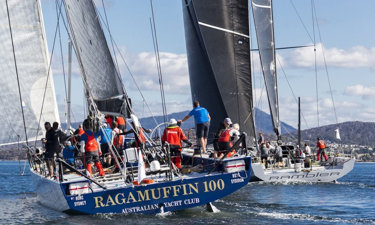 This handout photo from Rolex taken on December 29, 2015 shows Ragamuffin 100 (left) and Rambler (right) arriving in Hobart after the Sydney to Hobart yacht race. (STEFANO GATTINI/AFP/Getty Images)