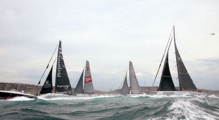 Maxi-yachts Loyal, left, Wild Oats XI, second from left, Ragamuffin 100 and Rambler, right, race past the first mark at the start of the annual Sydney Hobart yacht race in Sydney Saturday, Dec. 26, 2015. The 628-nautical-mile race started in Sydney Harbour and is expected to end two to three days later in Hobart, the capital of the island state of Tasmania. (AP Photo/Rick Rycroft)