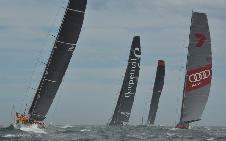 Photo taken on December 26, 2015 shows Supermaxi yachts Rambler (L) Perpetual Loyal (2nd-L) Wild Oats XI (R) and Comanche (2nd-R) after the start of the Sydney to Hobart yacht race in Sydney. (PETER PARKS/AFP/Getty Images)