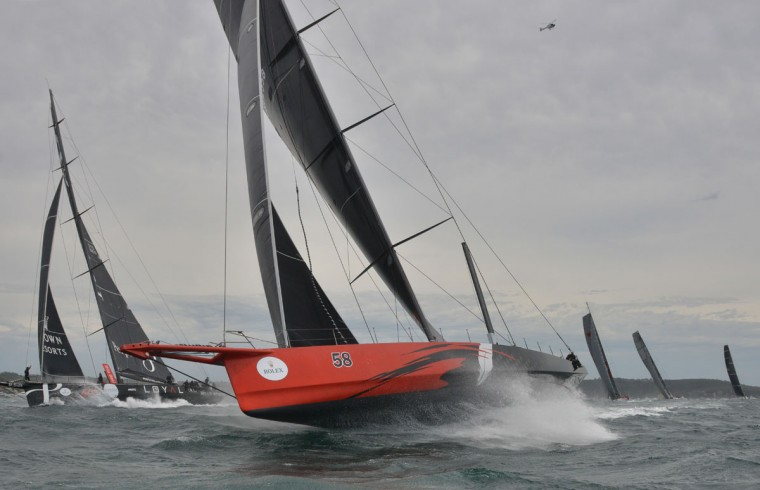 Photo taken on December 26, 2015 shows Supermaxi yachts Comanche (C) and Perpetual Loyal (L) after the start of the Sydney to Hobart yacht race in Sydney. (PETER PARKS/AFP/Getty Images)