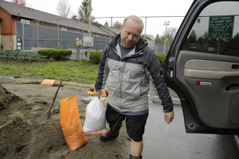 Mike Thawley carries a sandbag to his car Tuesday, Jan. 5, 2016, in San Anselmo, Calif. Californians were warned against abandoning conservation efforts Tuesday as several weeks of storms spawned by El Nino began hitting the West Coast. Heavy rain and snow are welcome after four years of drought in California, despite their potential for causing flash floods and mudslides. But even a very wet winter won't be enough to replenish water supplies depleted by four years of drought. (AP Photo/Eric Risberg)