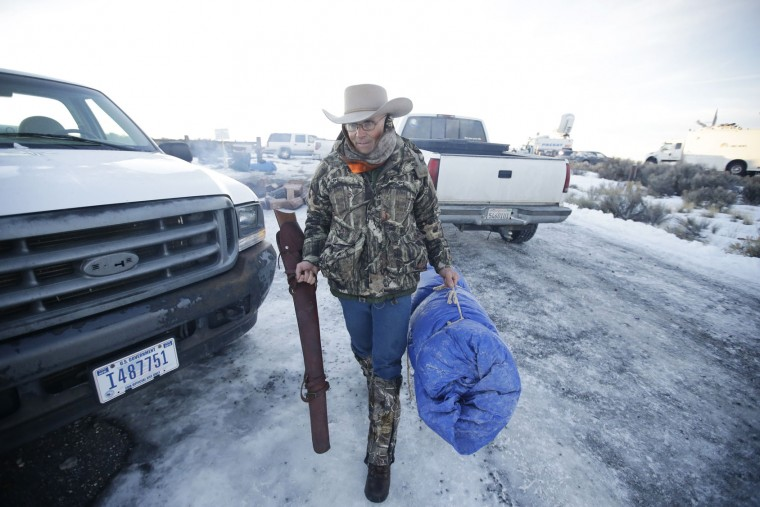 Arizona rancher LaVoy Finicum carries his rifle after standing guard all night at the Malheur National Wildlife Refuge, Wednesday, Jan. 6, 2016, near Burns, Ore. With the takeover entering its fourth day Wednesday, authorities had not removed the group of roughly 20 people from the Malheur National Wildlife Refuge in eastern Oregon's high desert country. But members of the group, some from as far away as Arizona and Michigan, were growing increasingly tense, saying they feared a federal raid. (AP photo/Rick Bowmer)