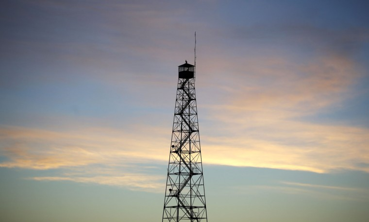 A watchtower is silhouetted at sunrise at the Malheur National Wildlife Refuge, Wednesday, Jan. 6, 2016, near Burns, Ore. The small, armed group occupying a remote national wildlife preserve has said repeatedly that local people should control federal lands — a sentiment that frustrates critics who say the lands are already managed to help everyone from ranchers to recreationalists. (AP photo/Rick Bowmer)