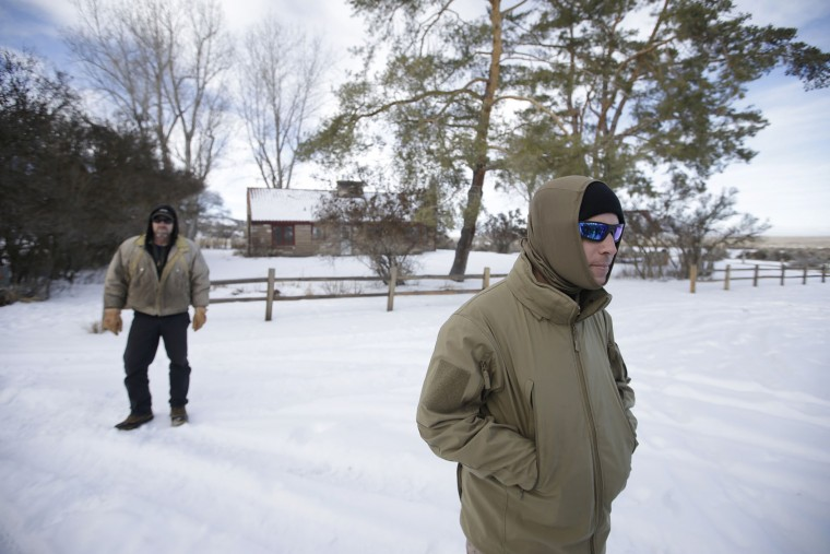 Members of the group occupying the Malheur National Wildlife Refuge look on during a media tour Wednesday, Jan. 6, 2016, near Burns, Ore. With the takeover entering its fourth day Wednesday, authorities had not removed the group of roughly 20 people from the Malheur National Wildlife Refuge in eastern Oregon's high desert country. (AP Photo/Rick Bowmer)