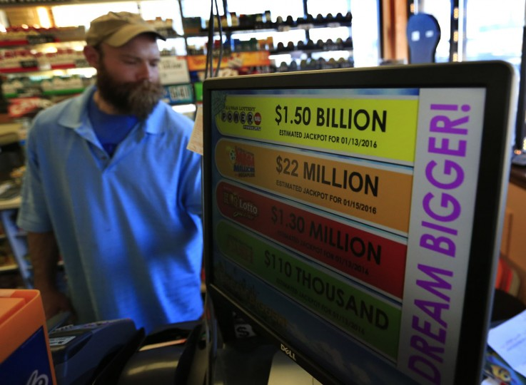 A clerk rings up a Powerball ticket at Git-n-Split convenience store in Topeka, Kan., Wednesday, Jan. 13, 2016. (AP Photo/Orlin Wagner)